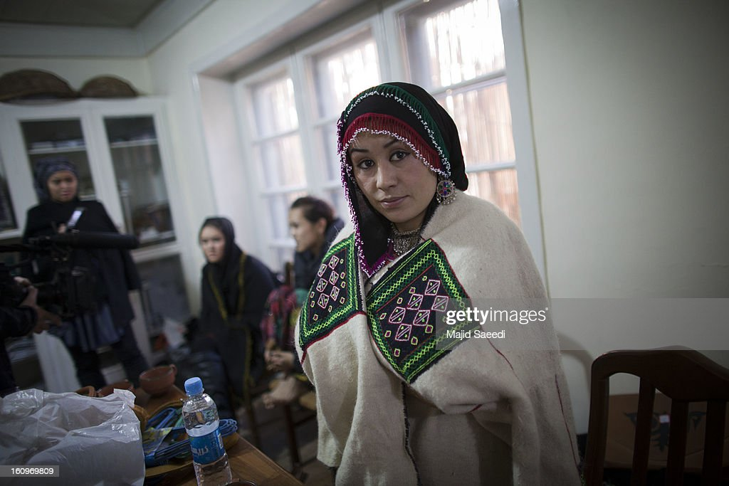 Models from 'Young Women For Change' prepare to showcase designs by Afghan designer, Shahr Banu Zeera, during her fashion show on February 8, 2013 in Kabul, Afghanistan. Last year 'Young Women For Change' opened a women's only internet cafe with money raised online, naming it after 14-year-old Sahar Gul, the victim of severe abuse at the hands of her family whose suffering made international headlines. This is Zeerak's first fashion show in the city.