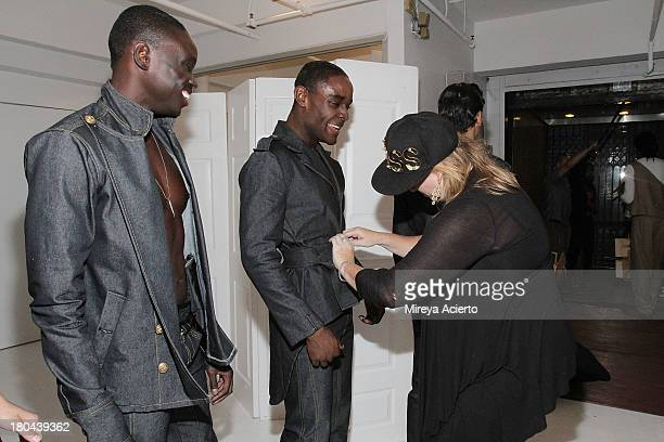 Models get dressed backstage at the St Wobil fashion show during MercedesBenz Fashion Week Spring 2014 at The Designer's Loft at Studio 450 on...