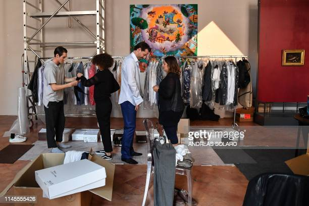 Models get dressed backstage prior to a preview of the Spring/Summer 2020 collection by Stefano Ricci an Italy's iconic Florencebased fashion house...