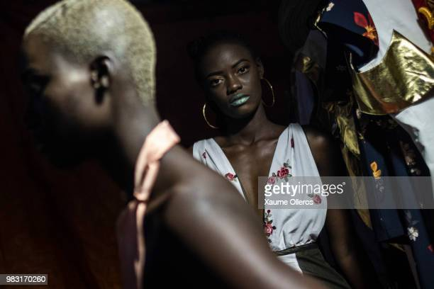 Models get ready ahead of the final day of the Dakar Fashion Week at the working class suburb of Keur Massar on June 24 2018 in Dakar Senegal