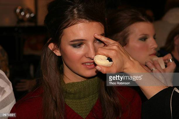 Models get ready backstage at the Jeffrey Chow Fall 2004 during Olympus Fashion Week February 12 2004 in New York City