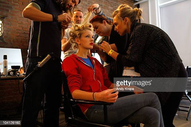 Models get ready backstage at the Jeremy Scott Spring 2011 fashion show during Mercedes-Benz Fashion Week at Milk Studios on September 15, 2010 in...