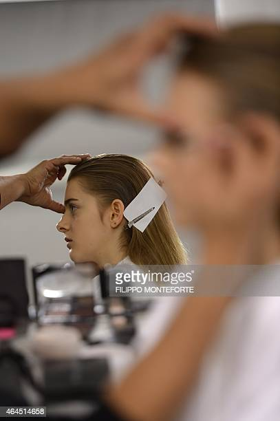 Models get ready backstage before the show for Anteprima at the women Fall / Winter 2015/16 Milan's Fashion Week on February 26 2015 AFP PHOTO /...