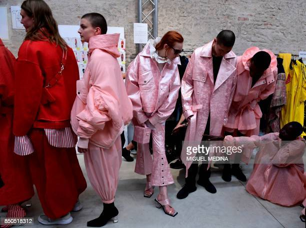 TOPSHOT Models get ready backstage before the show for fashion house Angel Chen during the Women's Spring/Summer 2018 fashion shows in Milan on...