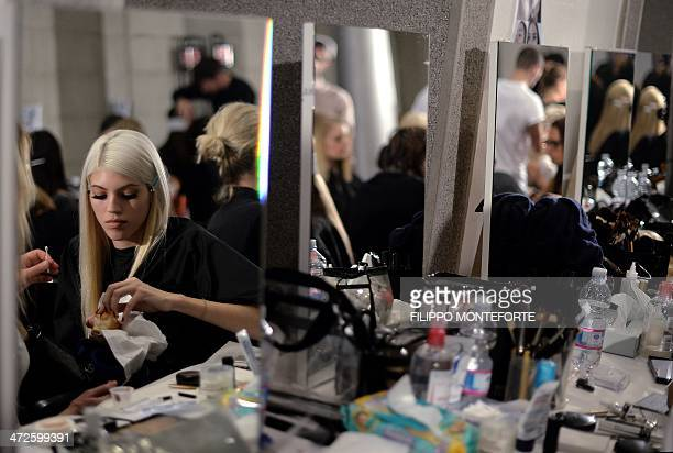 Models get ready backstage before Versace show as part of the presentations of the Women's fashion week Autumn/Winter 2014 collections in Milan on...