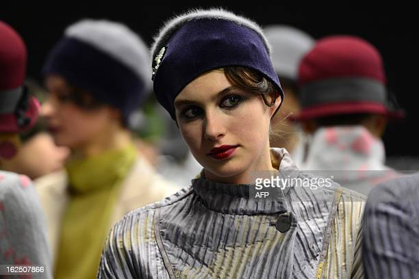 Models get ready backstage during the Emporio Armani FallWinter 20132014 Womenswear collection on February 24 2013 during the Women's fashion week in...