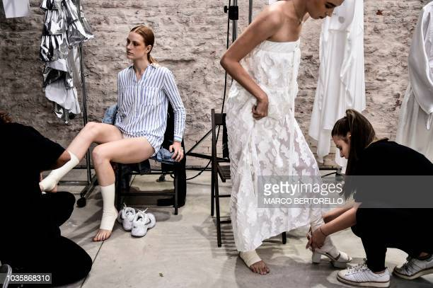 Models get ready backstage prior to present creations for fashion house Alberto Zambelli as part of the Women's Spring/Summer 2019 fashion shows in...