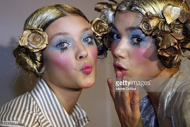 Models get ready backstage the John Galliano fashion show, during the Spring/Summer 2008 ready-to-wear collection show at Stade Francais on October...