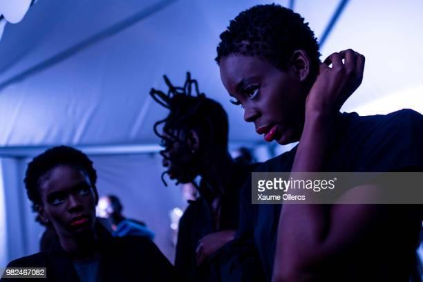 Models get ready during day three of the 16 Dakar Fashion Week at Radison Blu Hotel on June 23, 2018 in Dakar, Senegal.