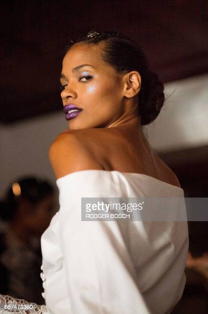 Models get ready in a historic Cape Town building for the show of Johannesburg designer David Tlale one of the highlights of the 2017 Mercedes Benz...
