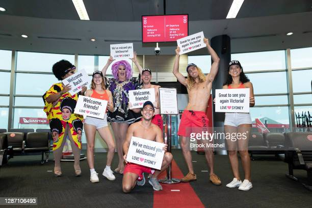 Models get ready to greet passengers from Melbourne at the Qantas Sydney Domestic terminal on November 23, 2020 in Sydney, Australia. The New South...