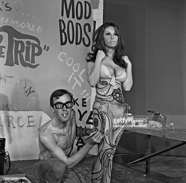 Models get their bodies painted for a 'paintin' in Los Angeles California in summer 1967