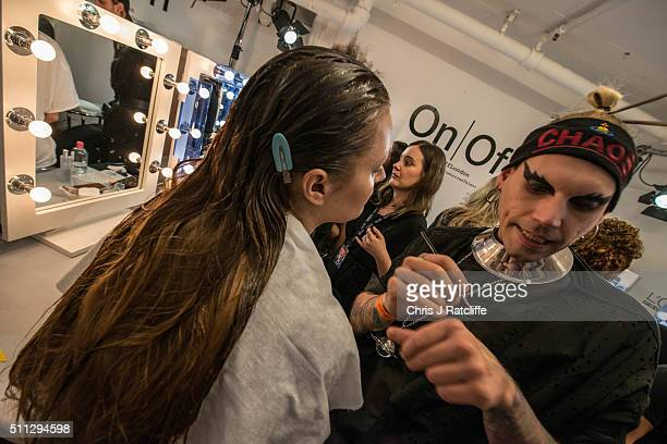 Models get their makeup done backstage at the punk themed 'On|Off Presents Punk Diversity' fashion show during London Fashion Week on February 19...