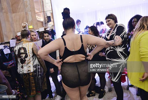 Models gets ready for a show part of the third edition of the Pulp Fashion Week Paris on April 11 2015 in Paris The Pulp Fashion Week event aims at...