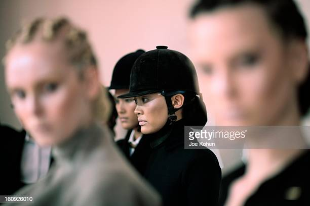 Models getting ready backstage at the Sukeina fall 2013 fashion show during MercedesBenz Fashion Week at Helen Mills Event Space on February 7 2013...
