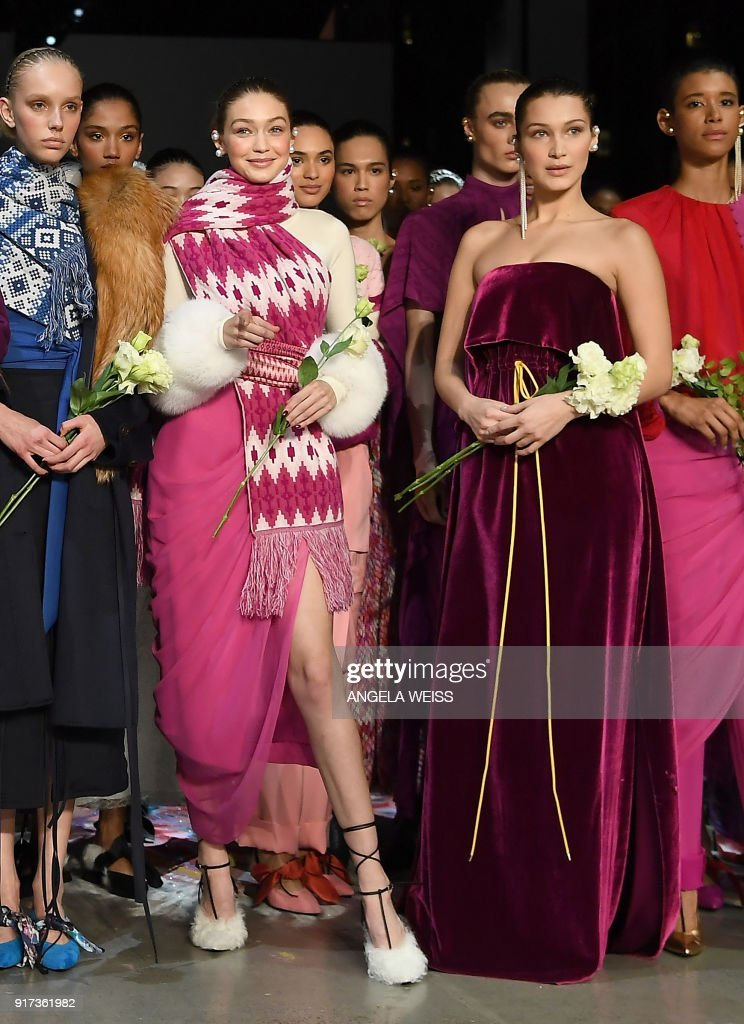 Models Gigi Hadid and Bella Hadid pose at the end of the runway for Prabal Gurung during New York Fashion Week: The Shows at Gallery I at Spring Studios on February 11, 2018 in New York City. /