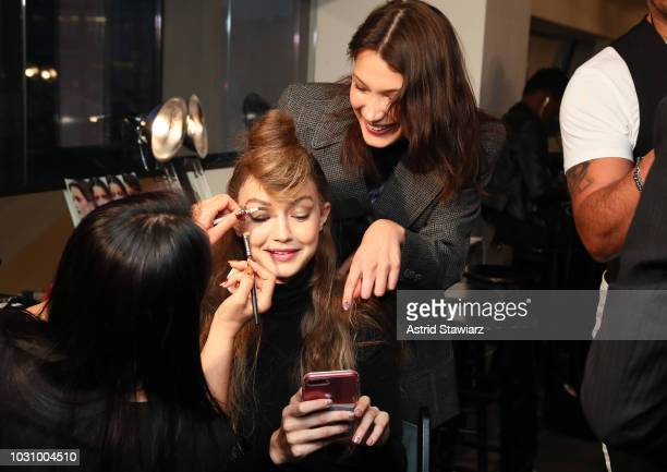 Models Gigi Hadid and Bella Hadid prepare backstage for the Anna Sui show during New York Fashion Week The Shows at Gallery I at Spring Studios on...