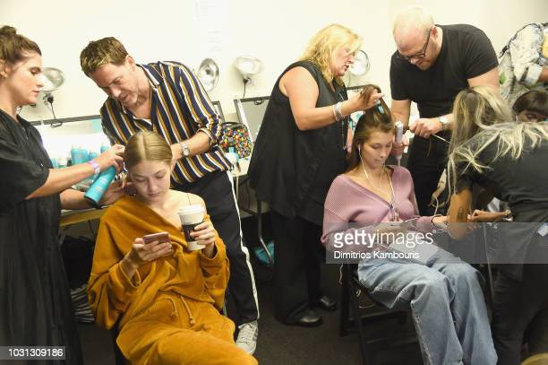 Models Gigi Hadid and Bella Hadid prepare backstage for the Oscar De La Renta show during New York Fashion Week The Shows at Spring Studios Terrace...