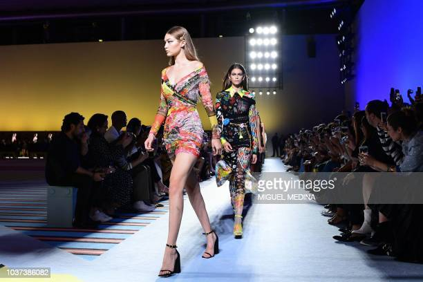 Models Gigi Hadid and Kaia Gerber present creations for Versace fashion house during the Women's Spring/Summer 2019 fashion shows in Milan on...