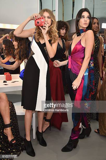 Models Gigi Hadid and Kendall Jenner pose wearing Diane Von Furstenberg Fall 2016 during New York Fashion Week on February 14 2016 in New York City