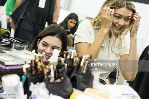 Models Gigi Hadid and Kendall Jenner prepare backstage before the Elie Saab show during Paris Fashion Week Womenswear Spring/Summer 2016 on October 3...