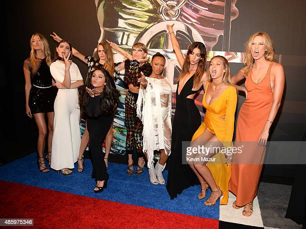 Models Gigi Hadid and Martha Hunt, actress Hailee Steinfeld, model Cara Delevingne, recording artists Selena Gomez and Taylor Swift, actress Serayah...