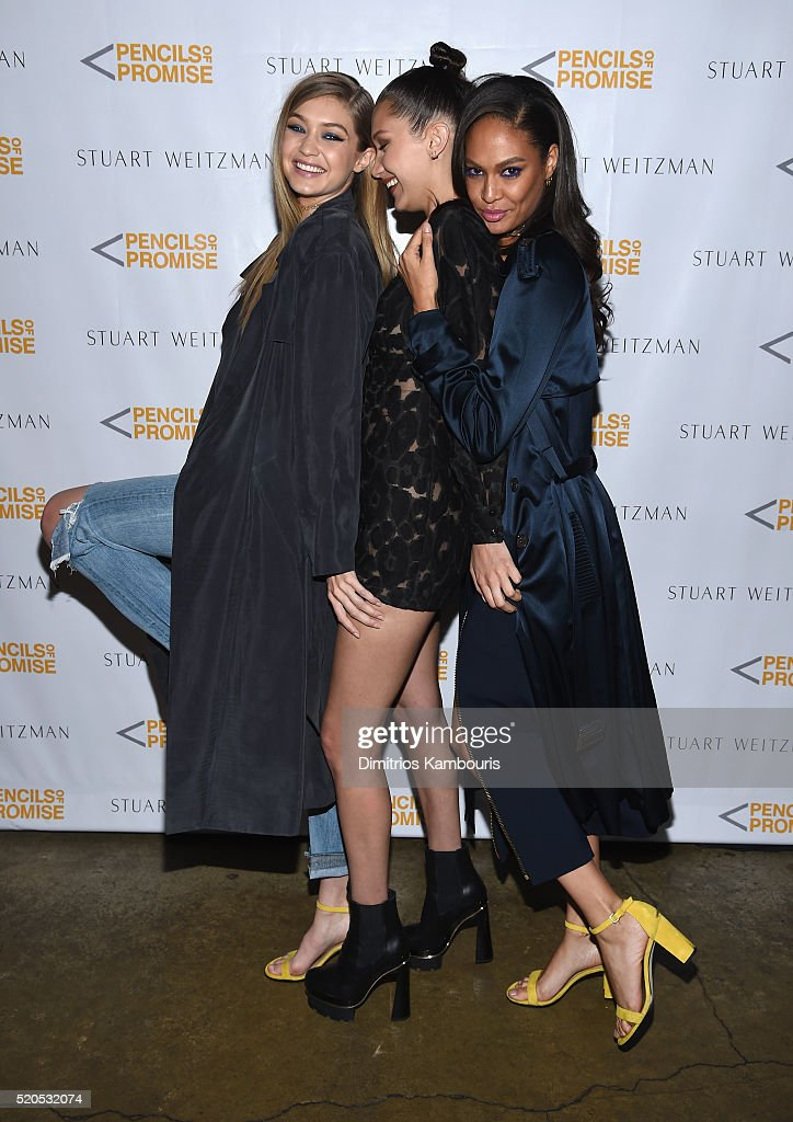Models Gigi Hadid, Bella Hadid and Joan Smalls attend as Stuart Weitzman launches its partnership with Pencils Of Promise at Sadelle's on April 11, 2016 in New York City.