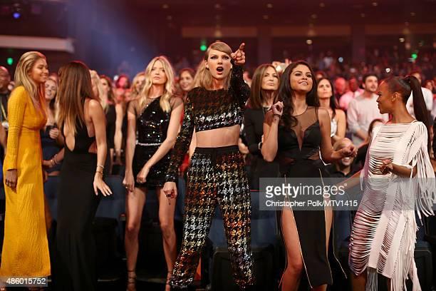 Models Gigi Hadid Lily Aldridge Martha Hunt recording artist Taylor Swift Selena Gomez and actress Serayah dance during the 2015 MTV Video Music...