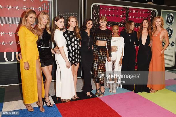 Models Gigi Hadid Martha Hunt actress Hailee Steinfeld model Cara Delevingne actress Selena Gomez musician Taylor Swift model Serayah actress Mariska...