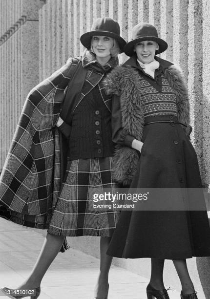 Models Gloria and Chris wearing woollen fashions and hats, UK, 7th May 1974.