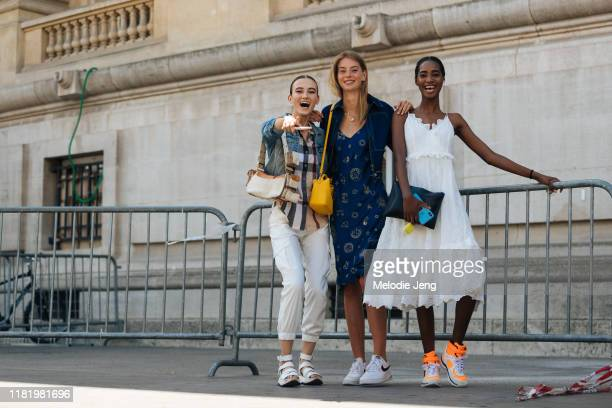 Models Greta Varlese, Lauren de Graaf, and Tami Williams point and laugh after the Chanel show during Couture Fashion Week Fall/Winter 2019 on July...