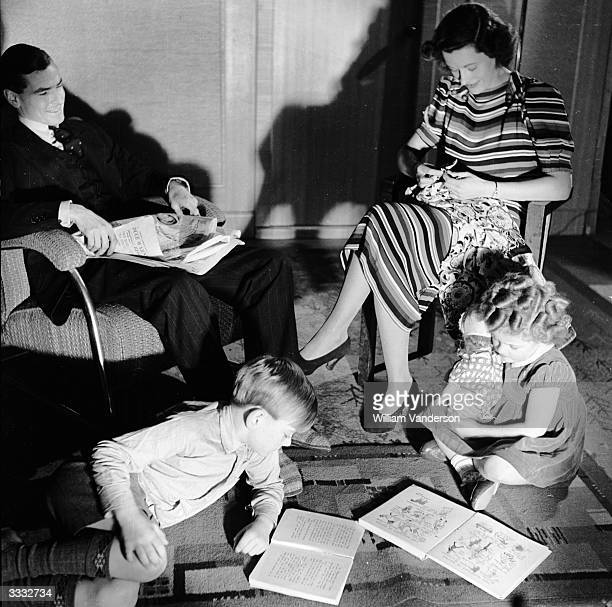 Models Guy Chaplin and Vera Dunlop at home with their children