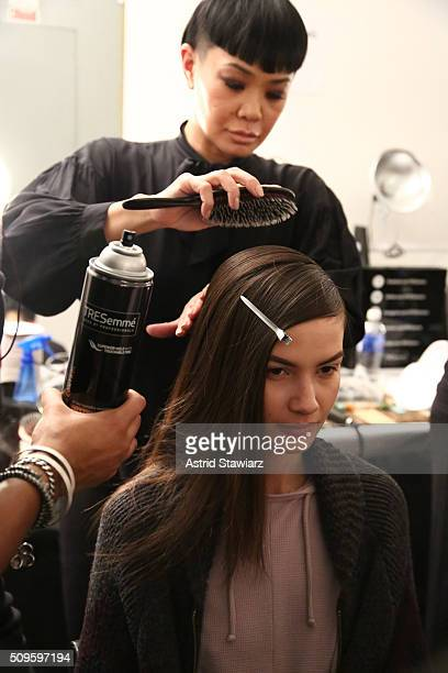 Models hair is prepared for TRESemme at Marissa Webb A/W16 Runway Show at The Gallery, Skylight at Clarkson Sq on February 11, 2016 in New York City.