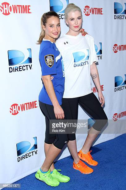 Models Hannah Davis and Ireland Baldwin attend the DirecTV Beach Bowl at Pier 40 on February 1 2014 in New York City