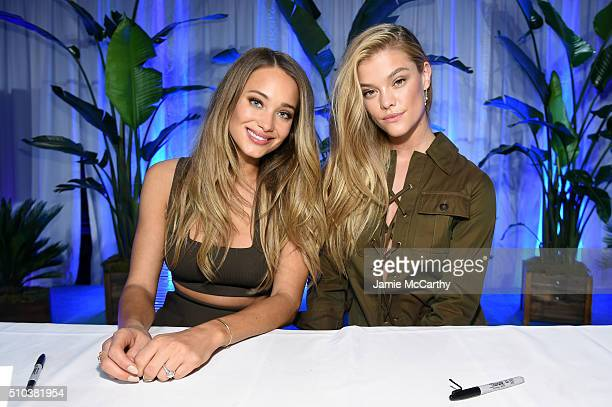Models Hannah Davis and Nina Agdal pose together at the Sports Illustrated Swimsuit 2016 Swim City at the Altman Building on February 15 2016 in New...