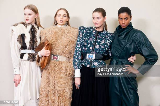 Models Hannah Motler, Luna Bijl and Imaan Hammam pose backstage in firstlooks before the Isabel Marant Womenswear Fall/Winter 2020/2021 show as part...