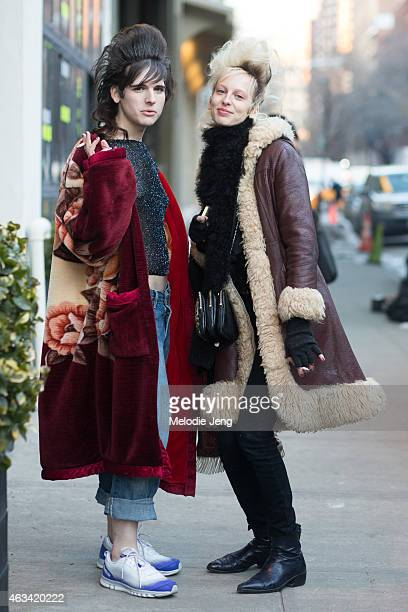 Models Hari Nef and Lili Sumner wears vintage on the Streets of Manhattan on February 13 2015 in New York City