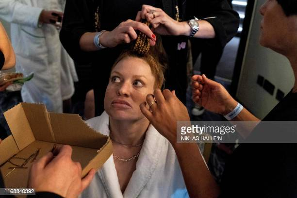Models have their hair and makeup prepared backstage ahead of the Vin + Omi catwalk show for their Spring/Summer 2020 collection on the final day of...
