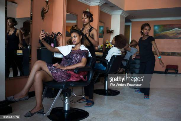 Models have their hair done at an upmarket salon during the HUB of Africa Fashion Week on October 21 2015 in Addis Ababa Ethiopia