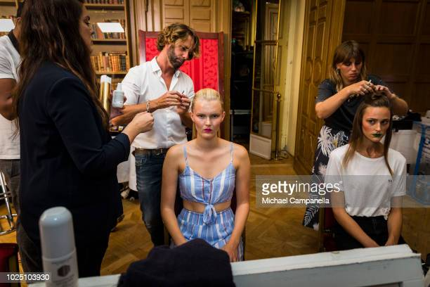Models have their hair prepared backstage on the second day of Fashion Week Stockholm at the Grand Hotel on August 29, 2018 in Stockholm, Sweden.