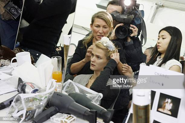 Models have their makeup applied backstage at the Chanel fashion show as part of Paris Fashion Week Spring/Summer 2006 on January 24 2006 in Paris...