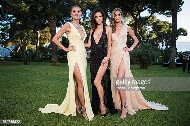 Models Heidi Klum Alessandra Ambrosio and Ana Beatriz Barros pose for photographs at the amfAR's 23rd Cinema Against AIDS Gala at Hotel du CapEdenRoc...