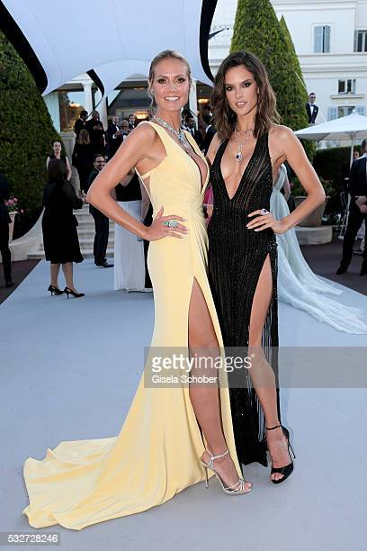 Models Heidi Klum and Alessandra Ambrosio attend the amfAR's 23rd Cinema Against AIDS Gala at Hotel du CapEdenRoc on May 19 2016 in Cap d'Antibes...