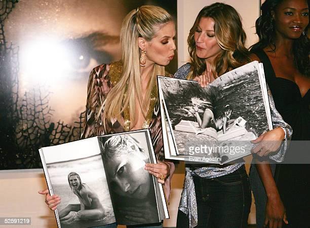 Models Heidi Klum and Gisele Bundchen attend the Victoria's Secret 'Sexy Volume 3 A Tribute to a Decade of Sexy Swimwear' photo exhibit and book...