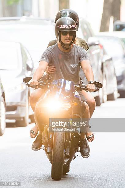 Models Hermann Nicoli and Candice Swanepoel seen riding a motorcycle on July 13, 2014 in New York City.