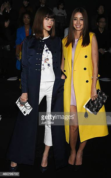 Models Hikari Mori and Izumi Mori are seen at the front row of 'Esprit Dior' Tokyo 2015 Fashion Show at Ryogoku Kokugikan on December 11 2014 in...