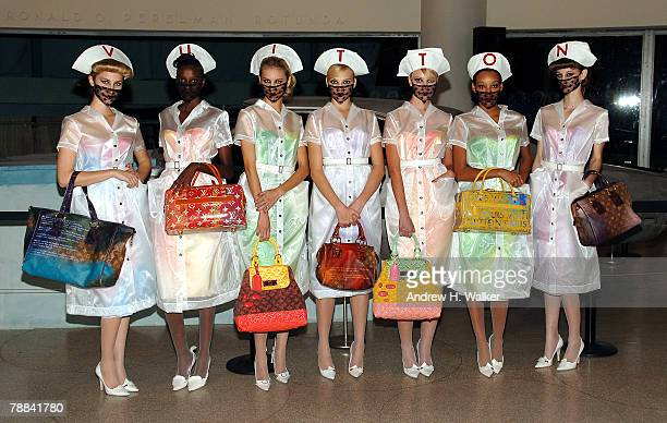 Models hold Louis Vuitton bags designed by Richard Prince at the Louis Vuitton cocktail reception celebrating the Richard Prince exhibition at the...