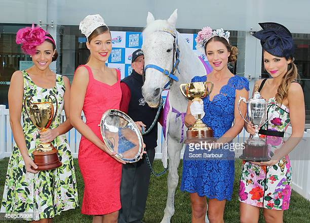 Models hold the Melbourne Cup The Cox Plate the Caulfield Cup and the Cranbourne Cup aloft as they pose with Subzero the 1992 Melbourne Cup Champion...