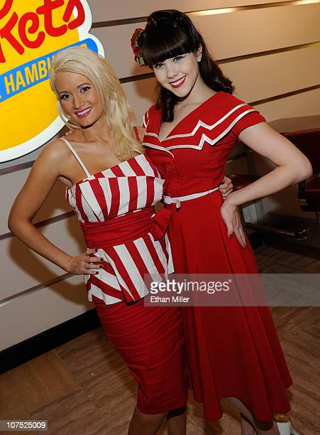 Models Holly Madison and Claire Sinclair appear in Bettie Page style dress at Johnny Rockets at the Flamingo Las Vegas to celebrate the restaurant's...