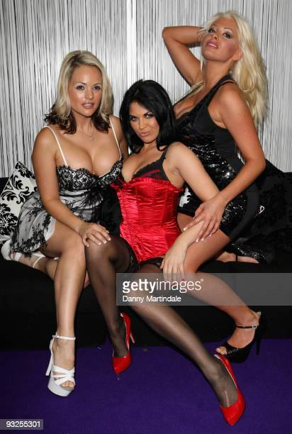 Models Holly McGuire Monica Harris and Leah Newman attend the annual 'Erotica' exhibition at Olympia Exhibition Centre on November 20 2009 in London...